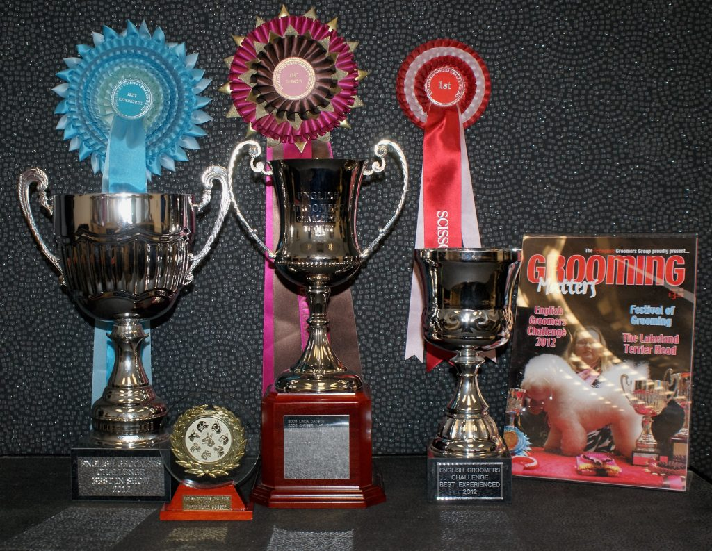 La Pooch dog grooming awards, trophies and rosettes.